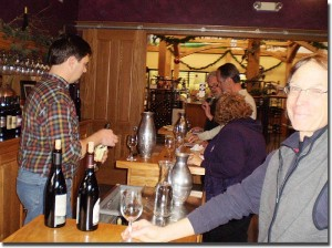 Lee Lutes behind the bar, a smiling Charlie Edson in front - click to enlarge