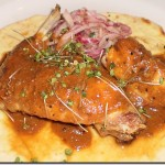 The Cooks' House rabbit roasted w/red mole and house made flour tortilla